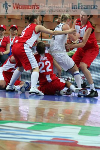 Players from Germany and Montenegro scramble for the ball